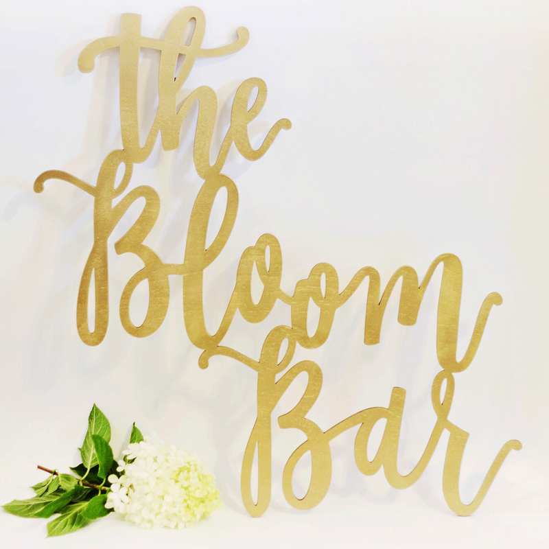 The Bloom Bar hand-lettered laser-cut wood sign