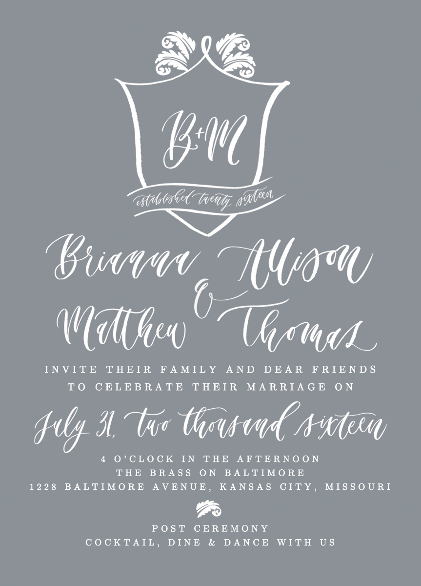 hand-lettered custom wedding invitation with crest